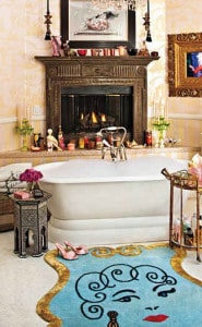This celebrity bathroom features a designer rug with the face sketch of Christina on it to give her a personalized bathing experience.