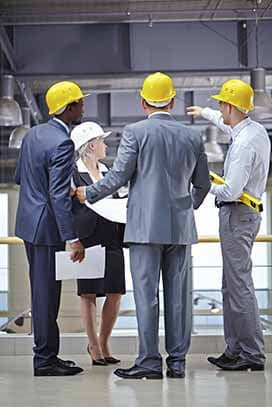 Three executive talking at a site