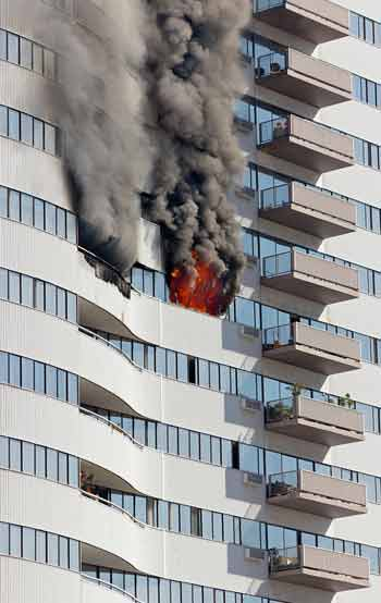 high rise building with smoke and fire