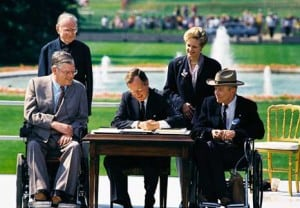 President George H. W. Bush signs the Americans with Disabilities Act of 1990 into law. Left to right: Evan Kemp, Rev. Harold Wilke, Pres. Bush, Sandra Parrino and Justin Dart.
