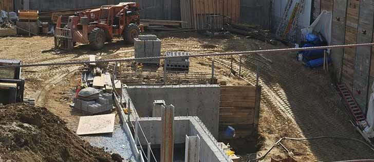 A constructiion site showing equipment and concrete work