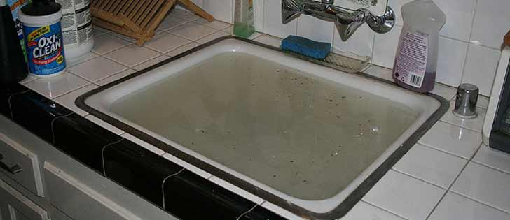 A sink filled with dirty water