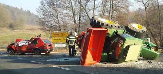 The scene of a car and tractor crash