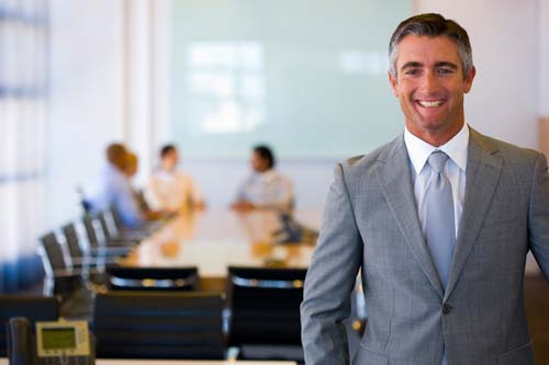 smiling man in board room