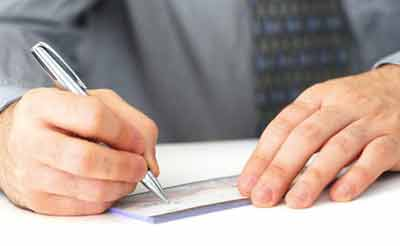 man writing a personal check