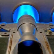 blue natural gas flames coming from furnace