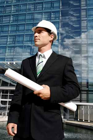 engineer standing in front of high-rise building