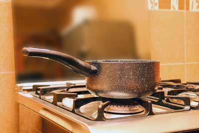cooking pot sitting on top of stove