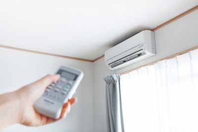 mini split AC unit on the wall of a home with remote control