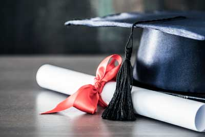 degree or diploma with graduating cap