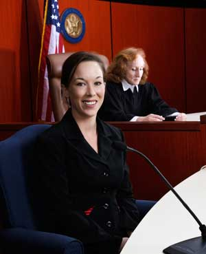 female expert testifying in court before a judge