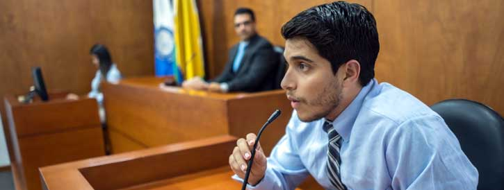 man serving as expert witness in a courtroom