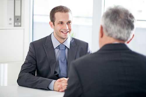 two men talking in an interview