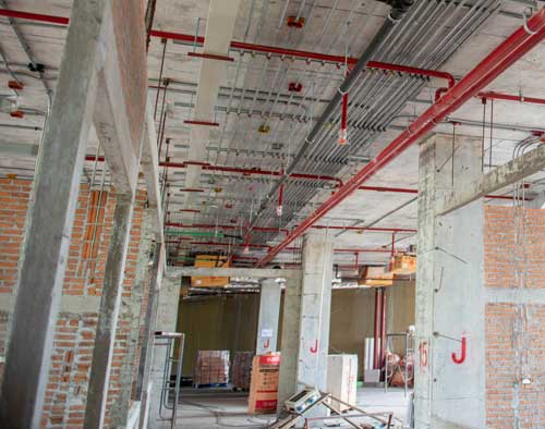 Building under contruction with fire suppression system