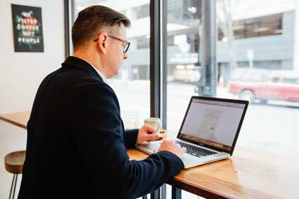 Man in suit on a laptop