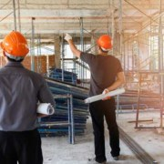 Two men discussing a building project at the site