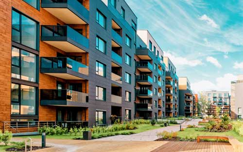 Multi-level apartment buildings with landscaping